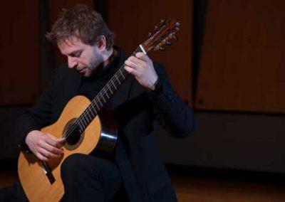 Marcin Dylla plays guitar
